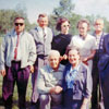Robert Kreem and Helene Johani visited Alberta on June 19, 1965 to collect historical material about Alberta's Estonian community and Alberta's Estonian pioneers. Robert Kreem is standing on the far right, Mrs. Johani is kneeling in front.