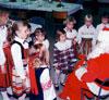 Estonian supplementary school children getting acquainted with Santa Claus (Jõuluvana) in Calgary, Alberta in 1988.