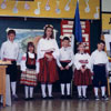 Five keen students, dressed in colourful Estonian folk costumes, ready to perform at the School in Calgary, Alberta in 1991.