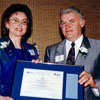 Co-founder of rhythmic gymnastics in Alberta, Helgi Leesment, receives a provincial award from Tourism Minister Don Sparrow in 1992.