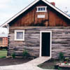 """This log home was built by Estonian pioneers and has housed Estonian artifacts. Formerly called """"Estonian House"""", the Museum currently refers to it as the """"Dovetail Log House"""". Estonian President Lennart Meri toured this cabin during his Alberta visit in 2000."""