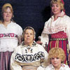 Tiiu Kalev and members of the Koppel family in traditional Estonian folk costumes in 1975. L to R: Standing Myrna and Tiiu Kalev. Sitting Mari Koppel and Lori Kalev.