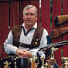 Ken Kotkas Sr. with all of his Trap Shooting Trophy's and guns.