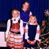 Three young Calgarians show off their colorful Estonian folk costumes during a Christmas Celebration in 1988. L to R: Erika Kivik, Krista Leesment and Milvi Tiislar.