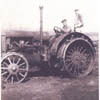Ernie and Jim Kerbes operate a tractor on their family farm near Stettler, Alberta.