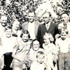 Back L to R: Five sons, Martin, Otto, Oscar, Alex and Mike. Front L to R: Leonard, Archie, Bob, Hilda(standing), Jenny, grandmother Liise, Marvin, Astrid, Harold, Julie (behind Harold) in 1937.